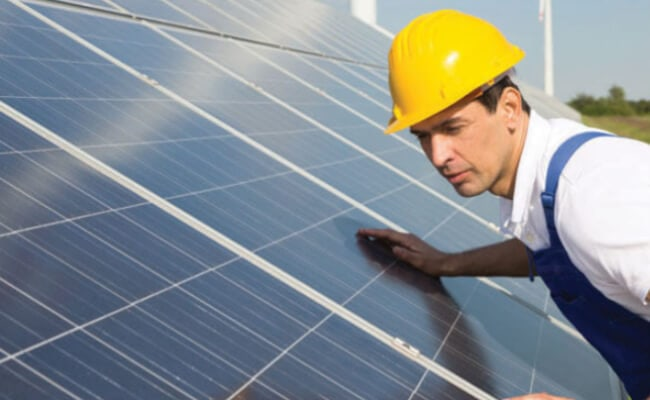 Solar Panel engineer working on solar panels